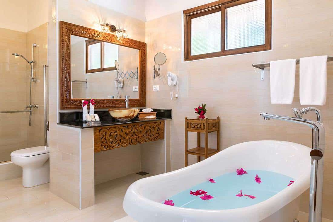 Bathroom with freestanding bathtub in luxury villa