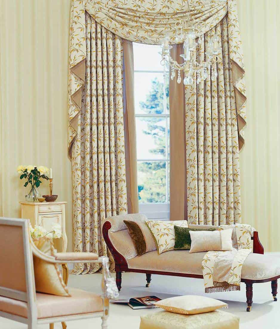 Beautiful classical living room with chair, chase lounge, window and curtain