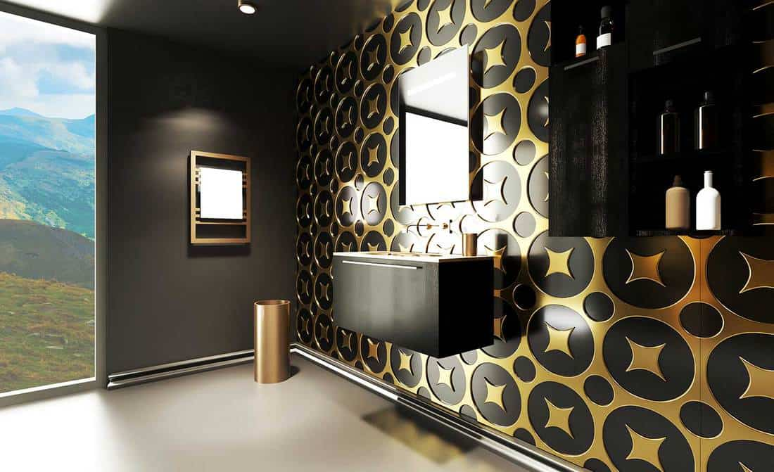 Black and gold themed modern bathroom with nature view glass window