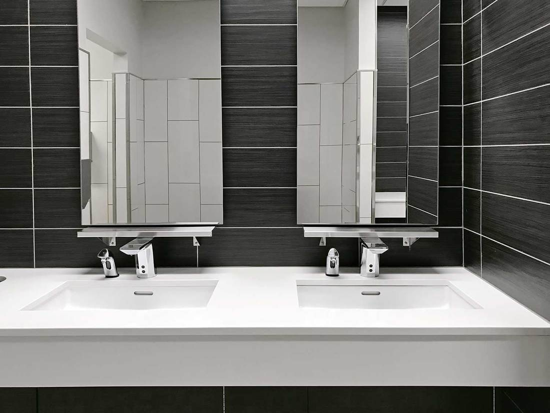 Black and white themed public restroom with two sinks
