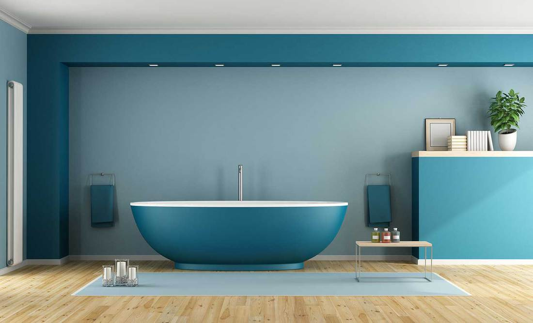 Blue modern bathroom with contemporary bathtub and parquet floor