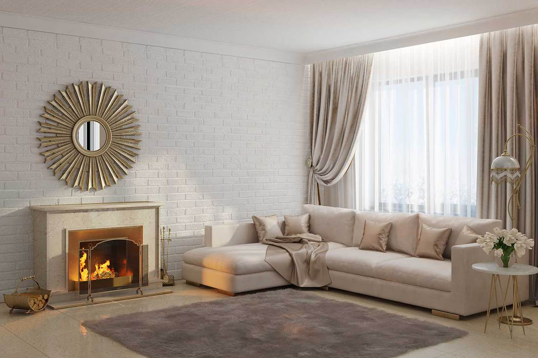 Bright and cozy modern living room with carpet, fireplace, corner sofa and gold framed mirror