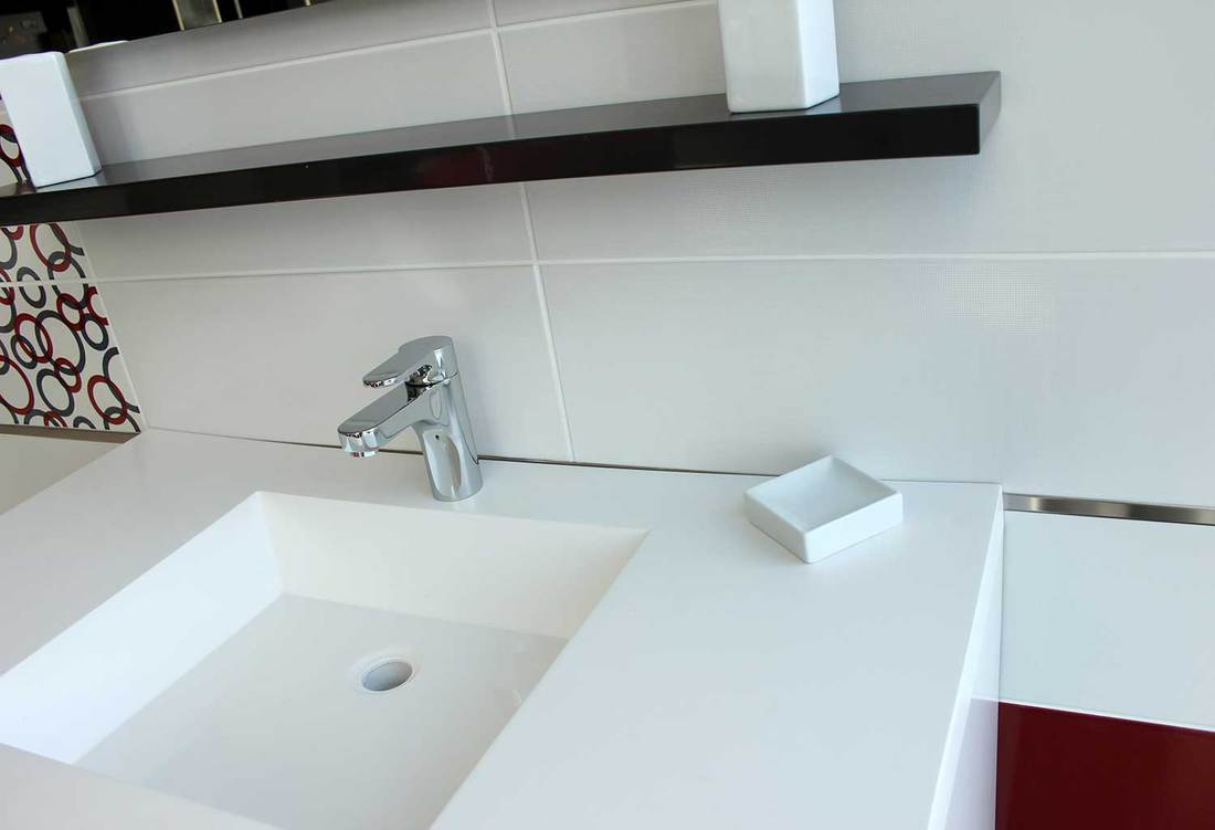 Clean white sink with chrome faucet