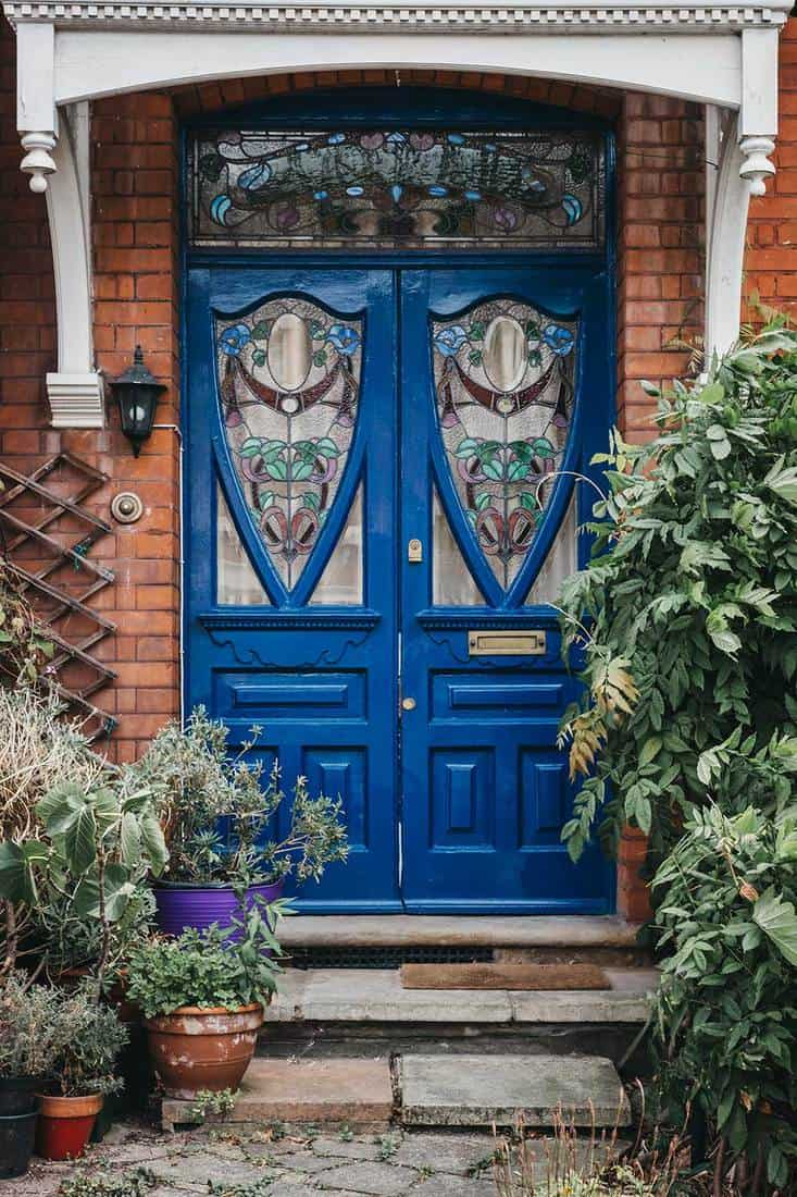 Colourful stained glass wooden door of a traditional Victorian house