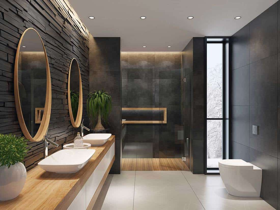 Contemporary minimalist bathroom with two round mirrors and two wash basins