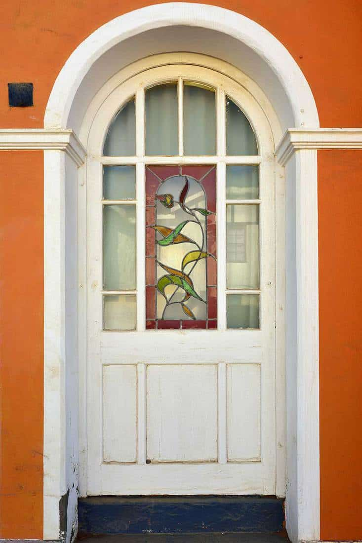 Door with stained glass of a historical building built in the early 20th century