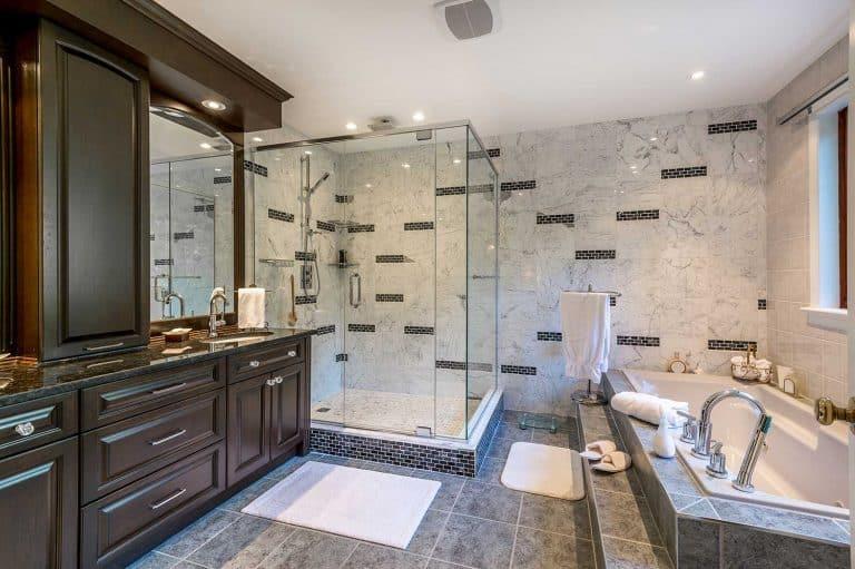 Elegant bathroom with bath tub and plexiglass shower