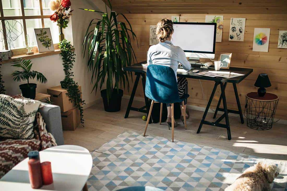 Female graphic designer working in creative home office studio