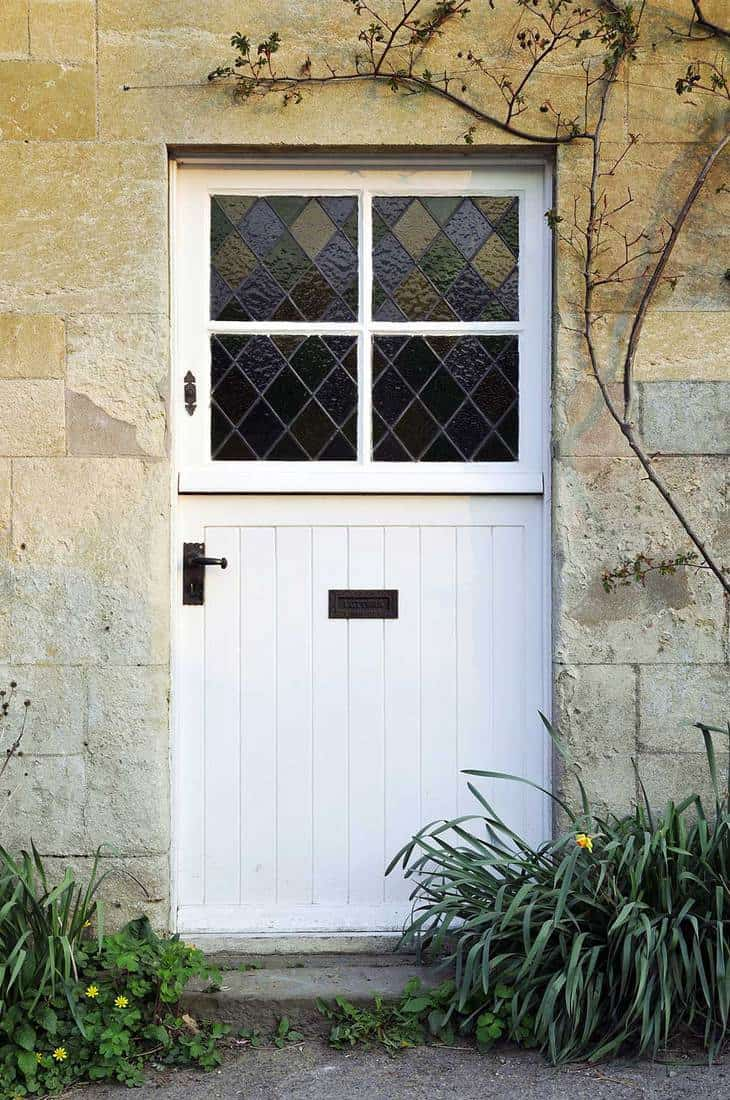 Front door with stained glass of an English cottage