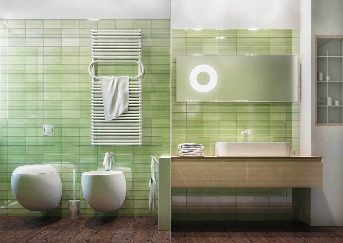 Frontal view of a clean and modern bathroom, green ceramic tiles, wood floor