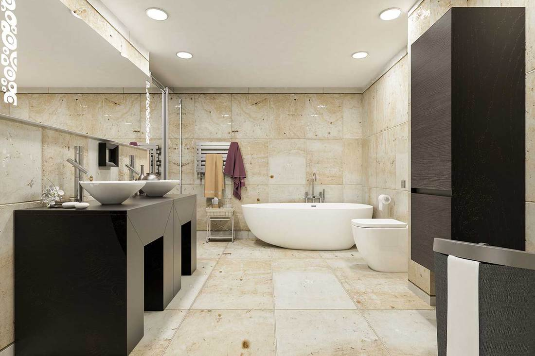 Fully tiled modern bathroom with bath tub, two sinks and large mirror