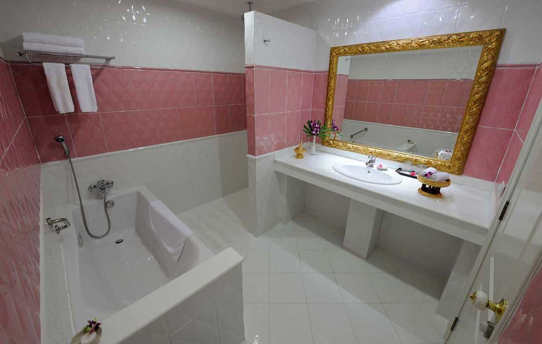 Glamorous luxury bathroom with pink and white wall tiles