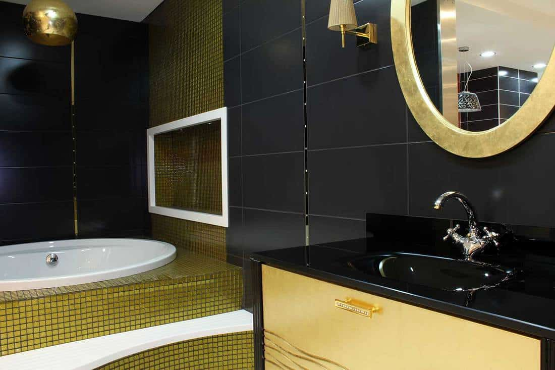 Gold and black themed bathroom