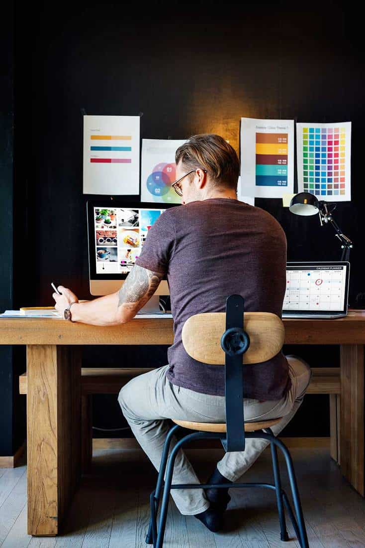 Graphic designer in home office working
