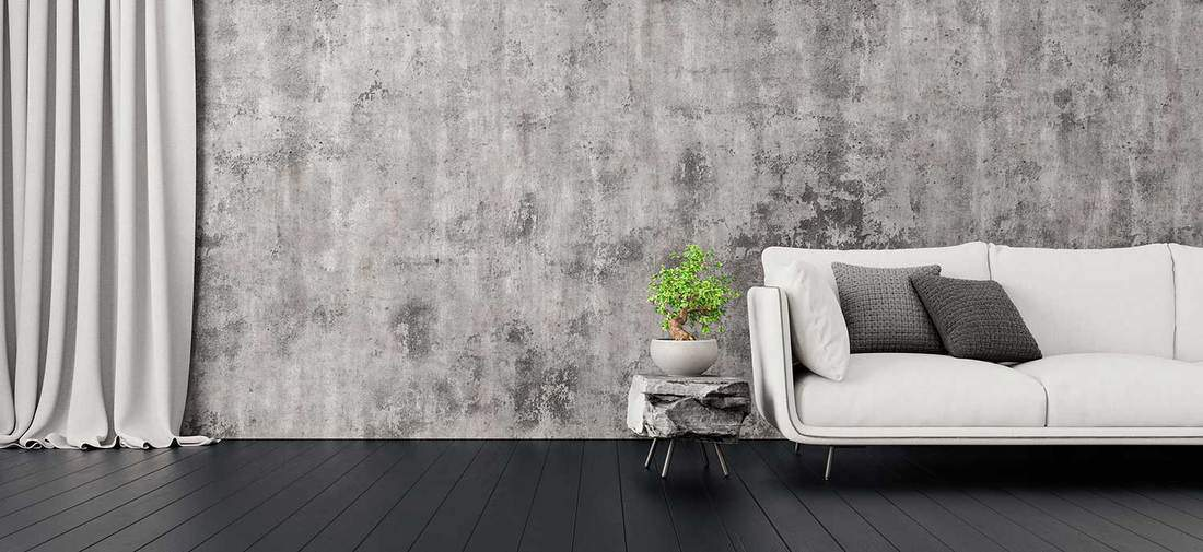 Grey themed minimalist living room interior with concrete wall, modern furniture and dark wood floor