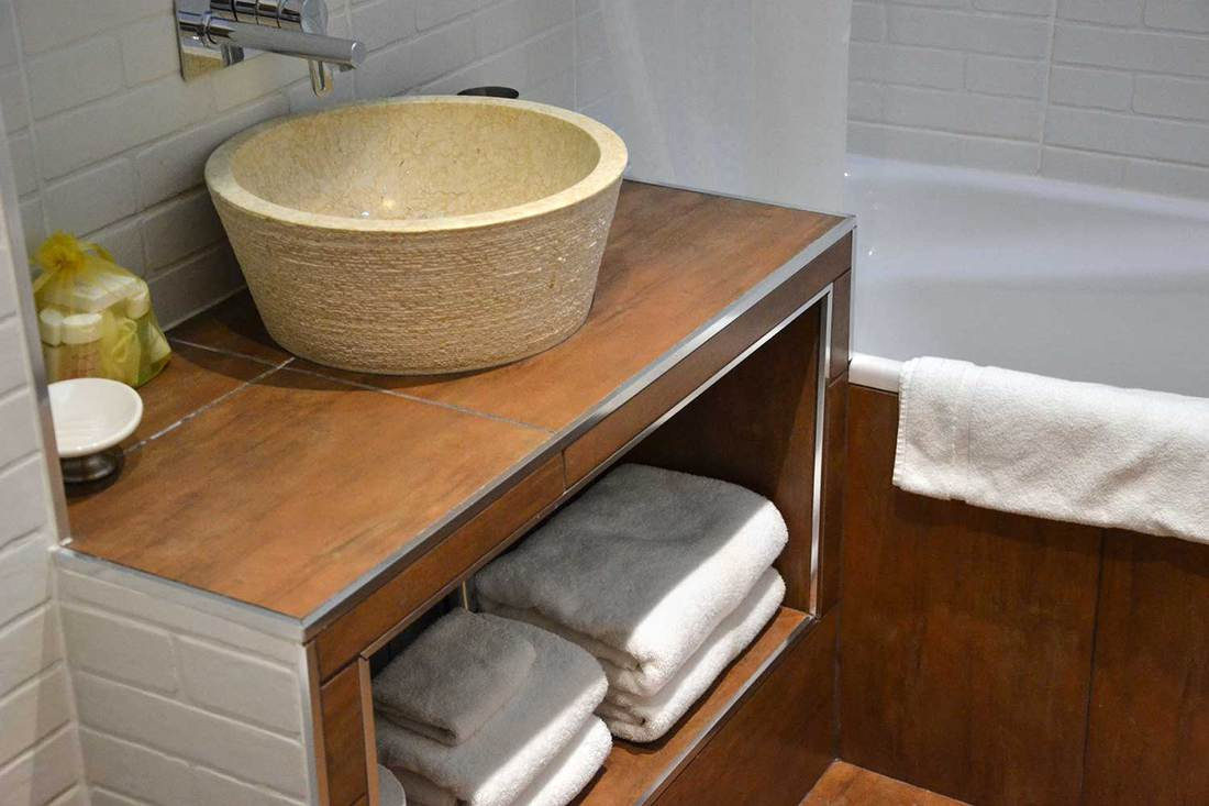 Hotel bathroom sink with towels