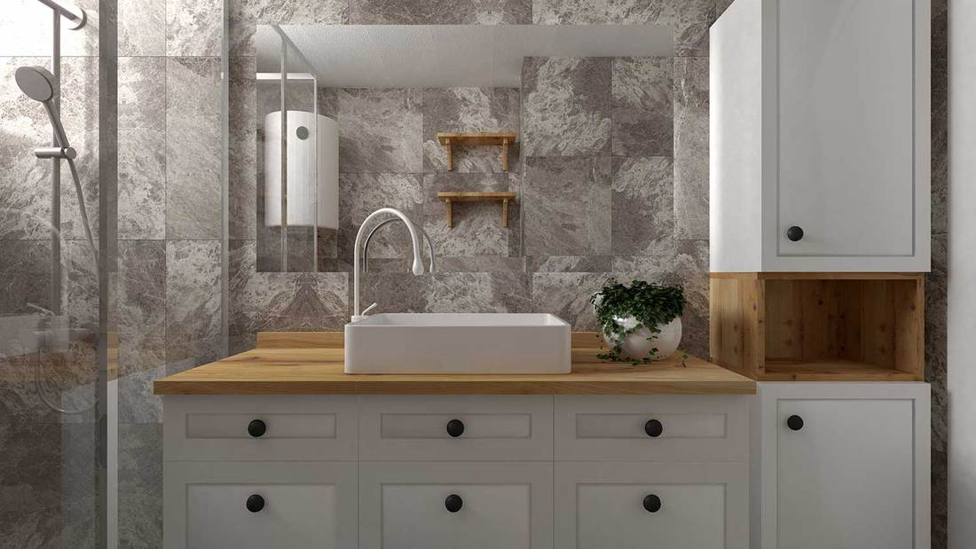 Interior design of a modern and contemporary bathroom with white cabinets, ceramic wash basin, shower and large mirror