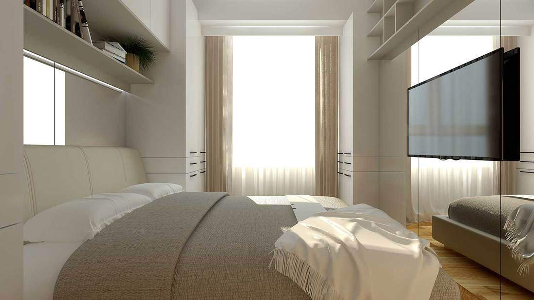 Interior design of a small bright modern bedroom with widescreen tv on large mirror