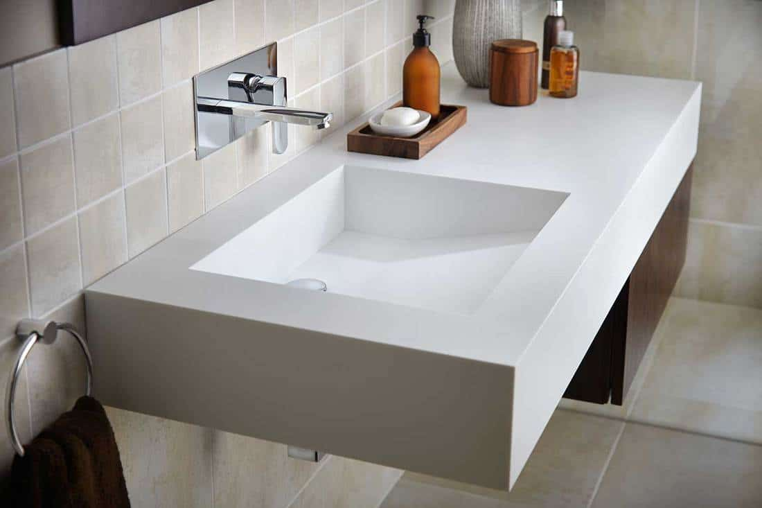 Interior of a bathroom tiled walls and white wash basin