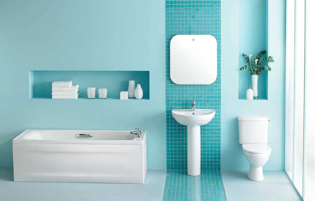 Interior of large luxurious bathroom in turquoise blue