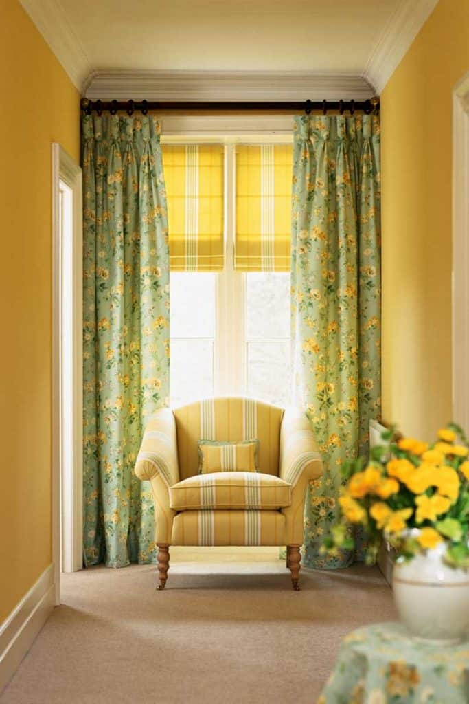 Yellow walls with Yellow-striped couch and floral green and yellow drapes