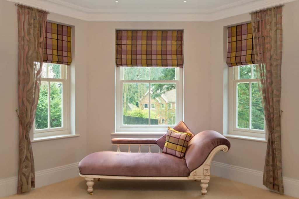 Curved wall with Irish themed woven blinds