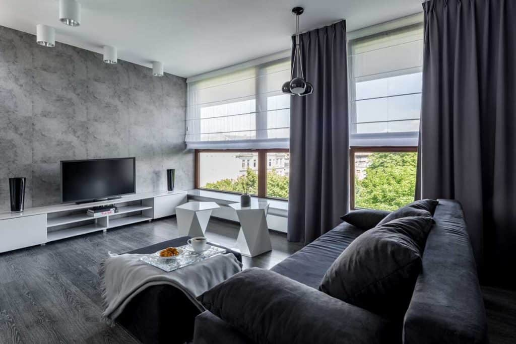 Modern design living room with grey curtains and brown and white furniture
