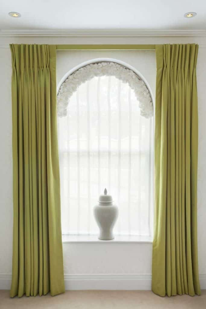 Green drapes with arc window