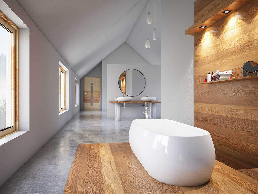 Large modern house bathroom interior with ceramic bathtub, large round mirror above wash basins