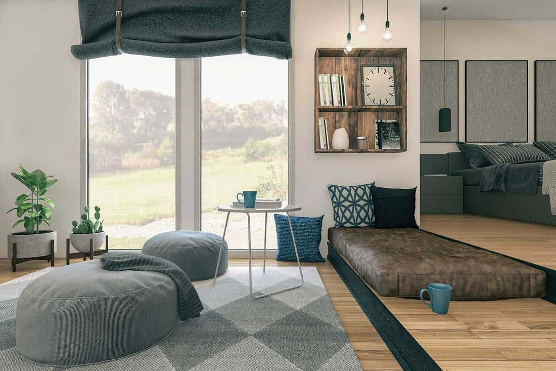 Loft type apartment with cozy interior and garden view glass window