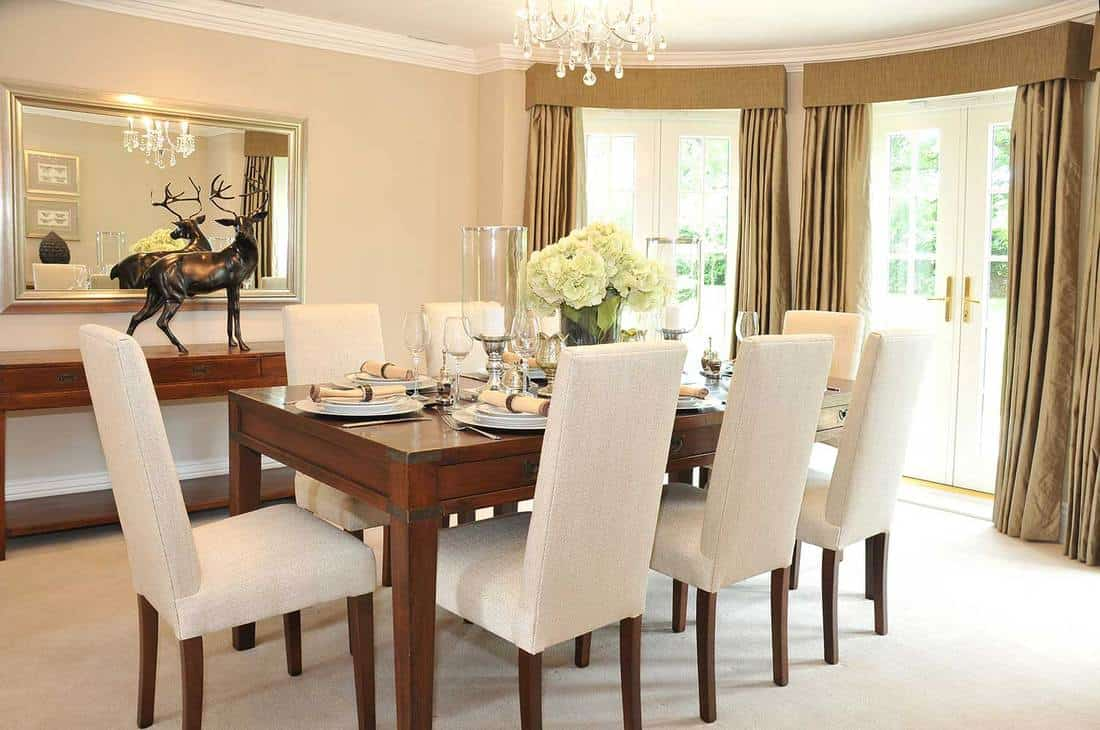 Luxurious dining room interior with rustic dining table