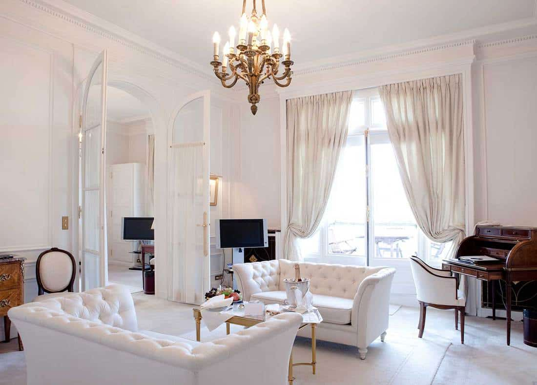 Luxurious white living room interior of a hotel suite