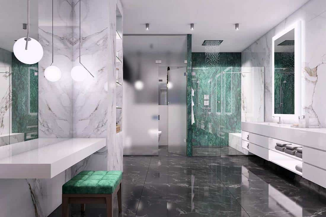 Luxury bathroom interior with marble walls, large mirrors, shelf, decorative ceiling lights and glass shower