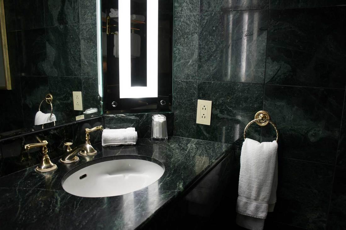 Luxury dark green marble bathroom interior
