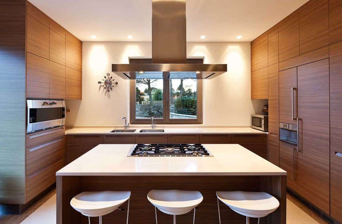 Luxury kitchen interior with island table and glass window