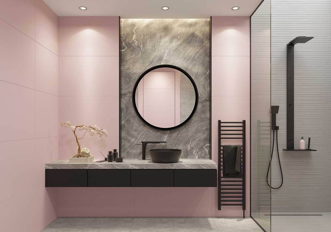 Luxury light pink and bold black bathroom with large wall tiles and natural gray stone block