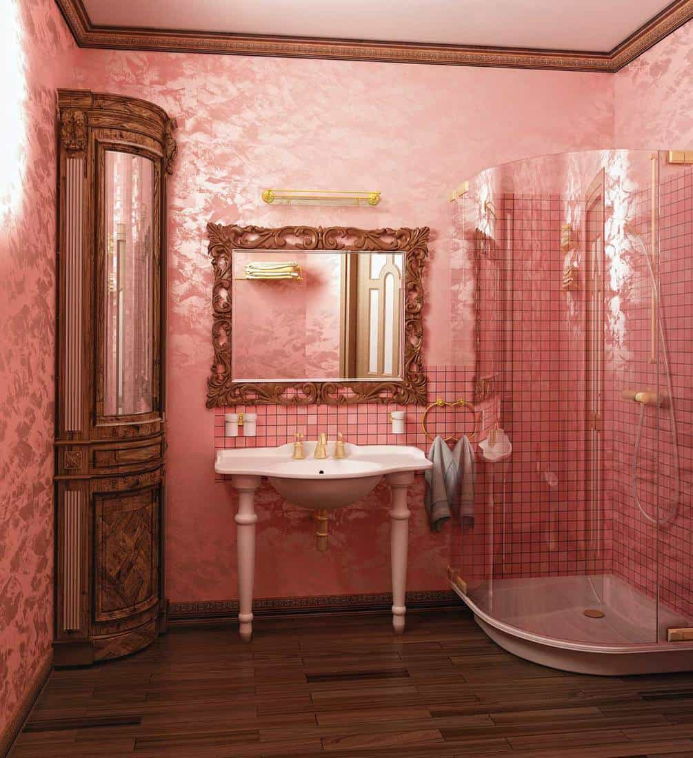 Luxury pink coloured bathroom interior with parquet flooring