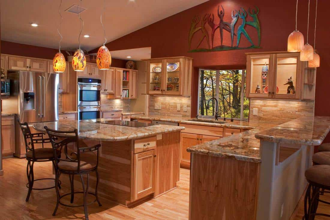 Luxury remodeled kitchen with granite countertops and stainless steel appliances