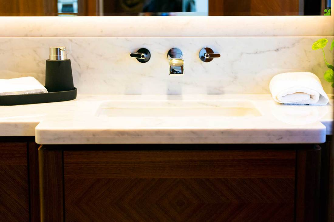 Luxury white marble sink with white towel and large mirror