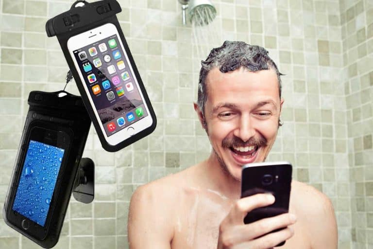 Man using cellphone while having a shower