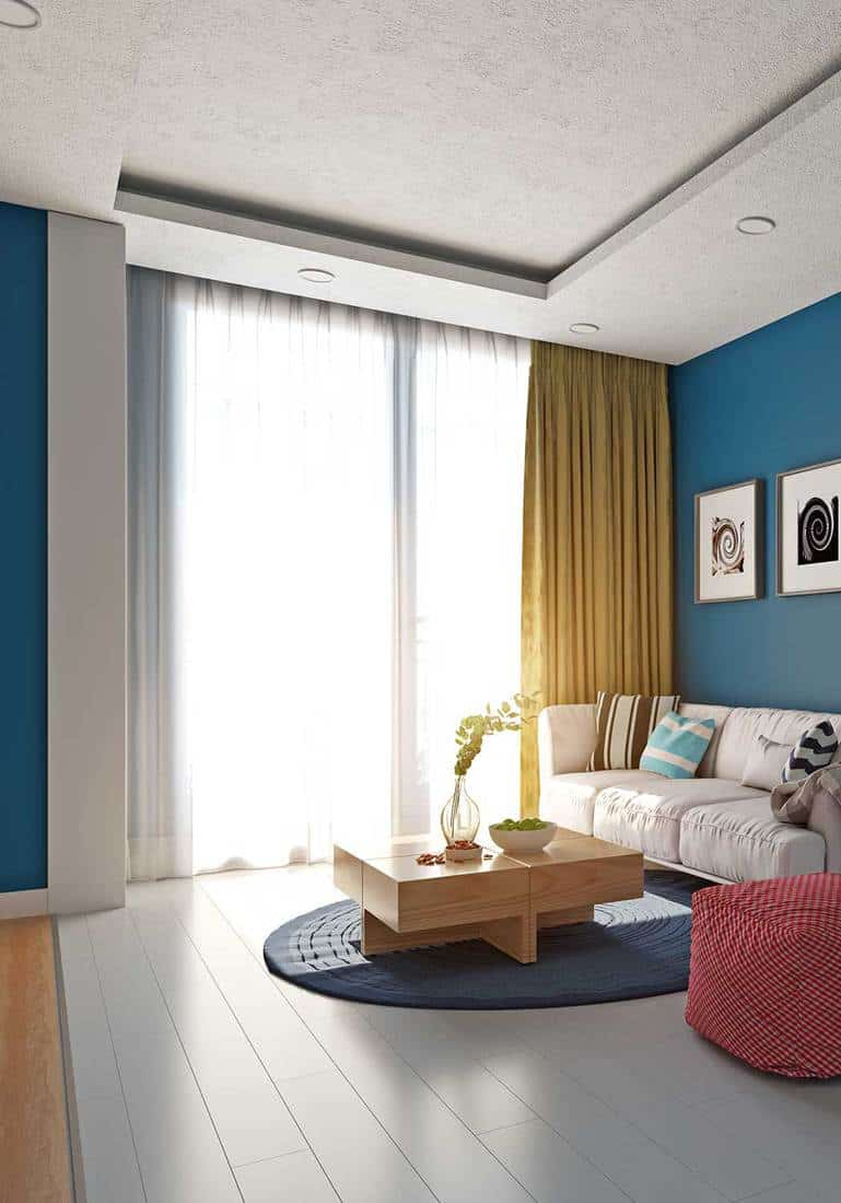 Modern apartment living room interior with blue walls
