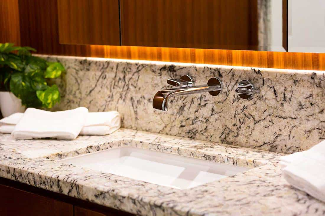 Modern bathroom interior with marble countertop and mirror