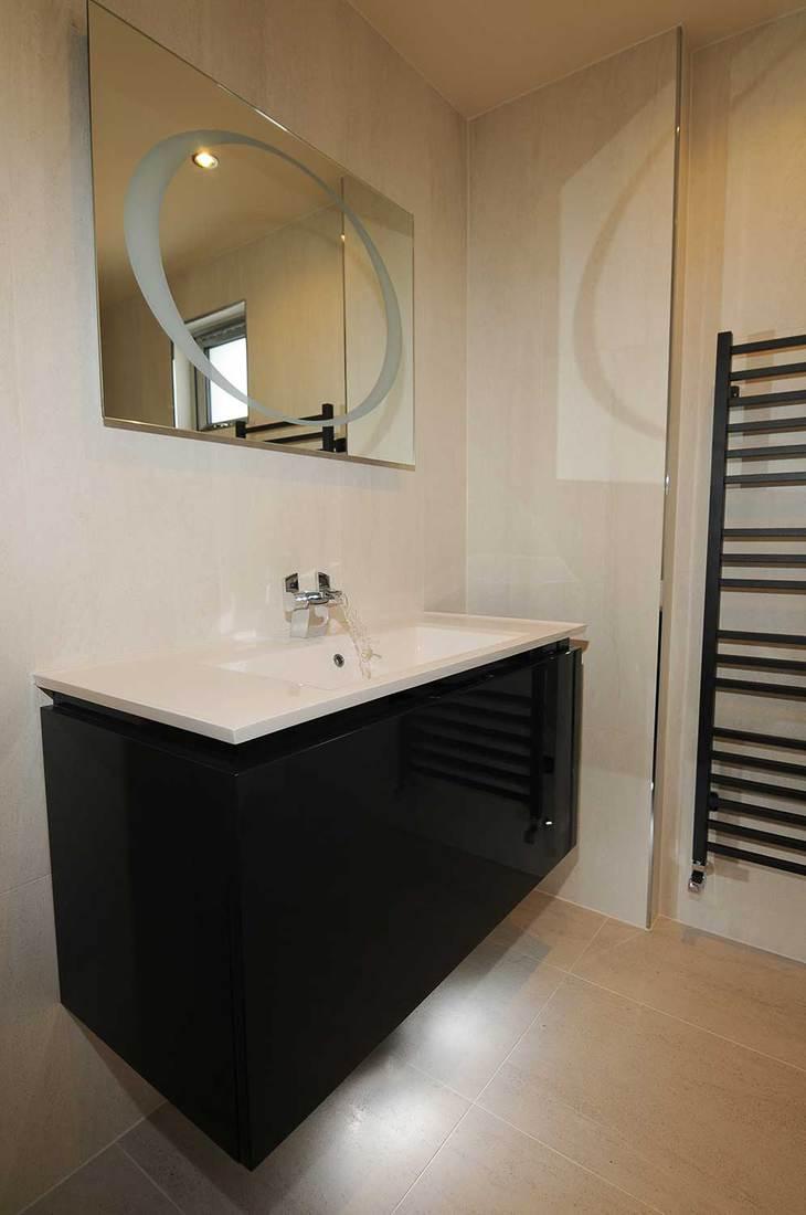 Modern bathroom sink interior with mirror