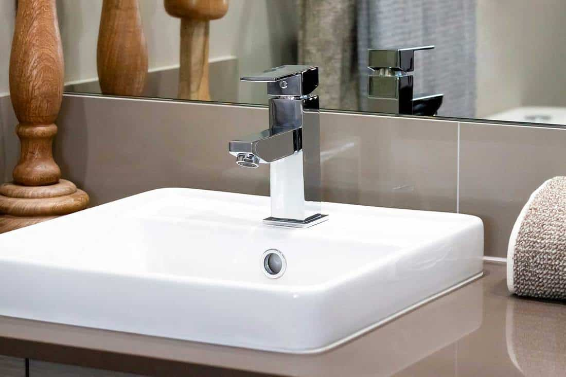 Modern bathroom sink with stainless steel chrome faucet