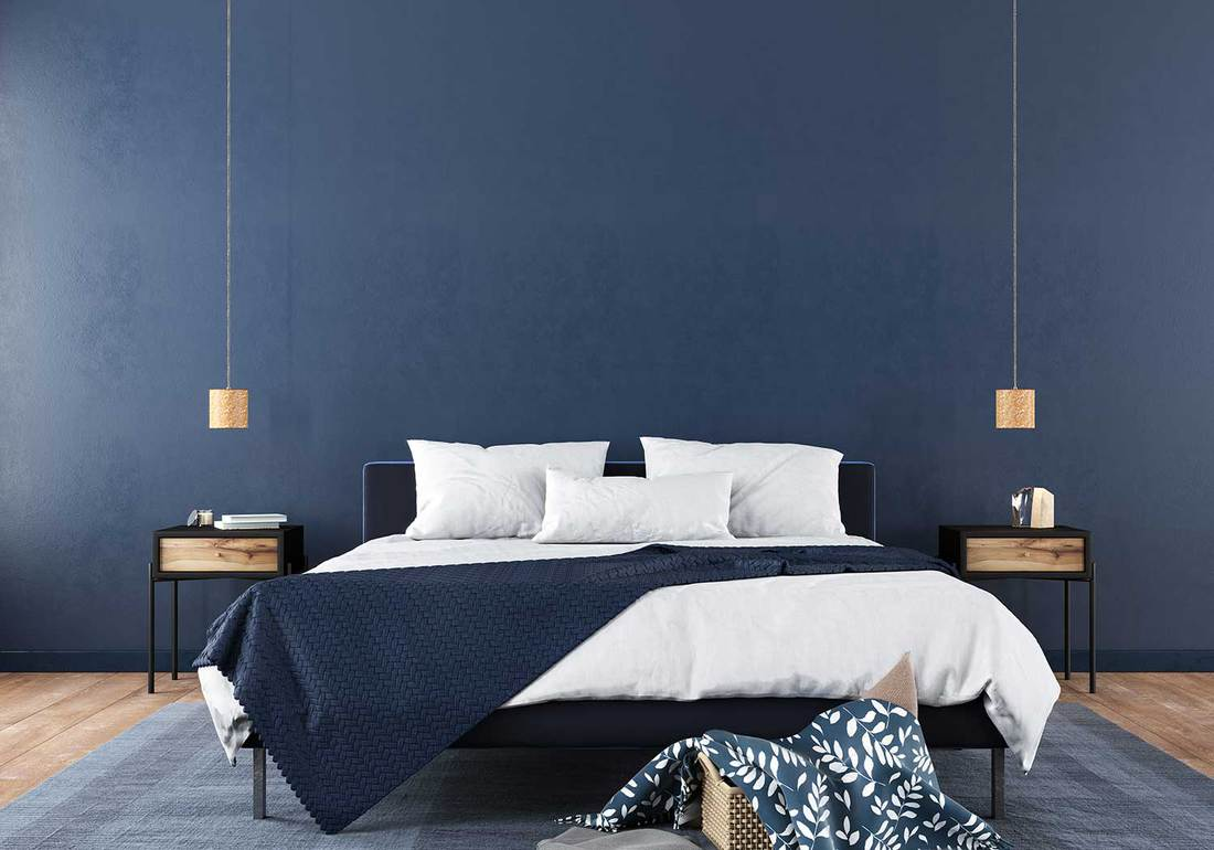 Modern bedroom interior with a stylish combination of trendy blue and light wood texture