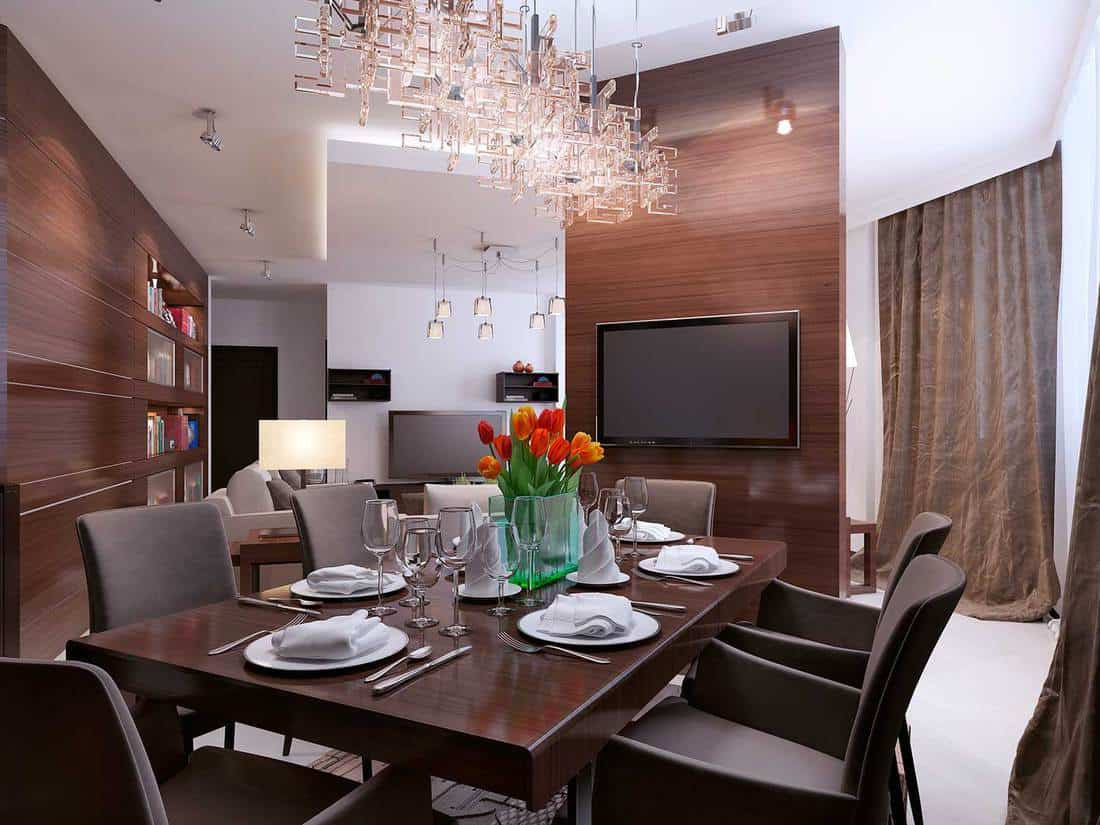 Modern dining room interior with TV in a loft style apartment