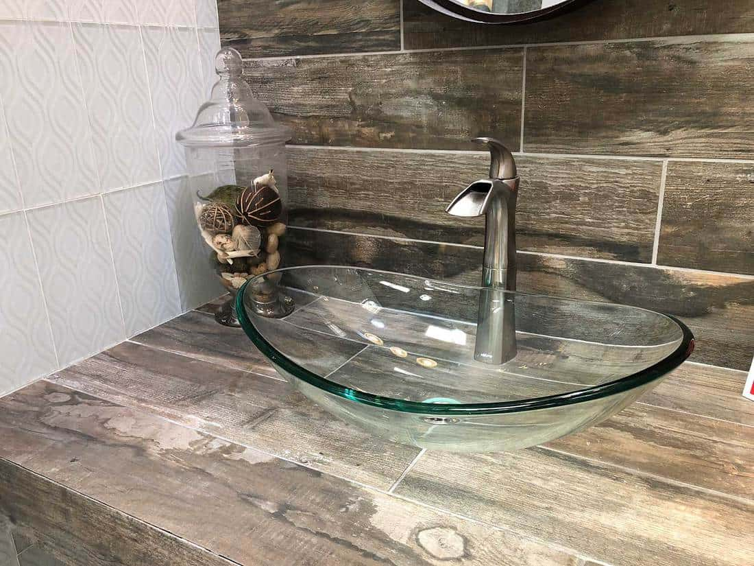 Modern glass wash basin with chrome faucet