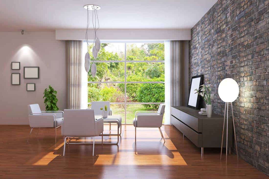 Modern house living room interior with brick walls and garden view large window