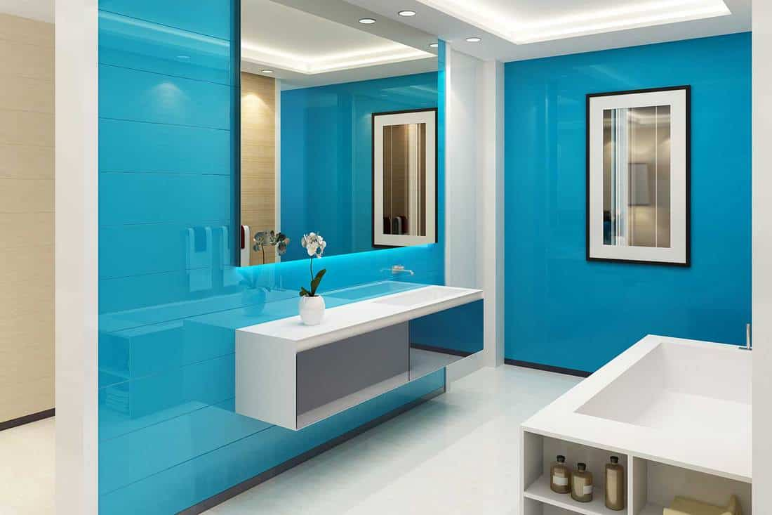 Modern interior bathroom with blue walls, large glass and white sink