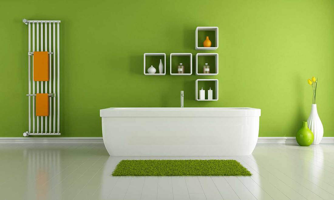 Modern interior of a green and white themed bathroom
